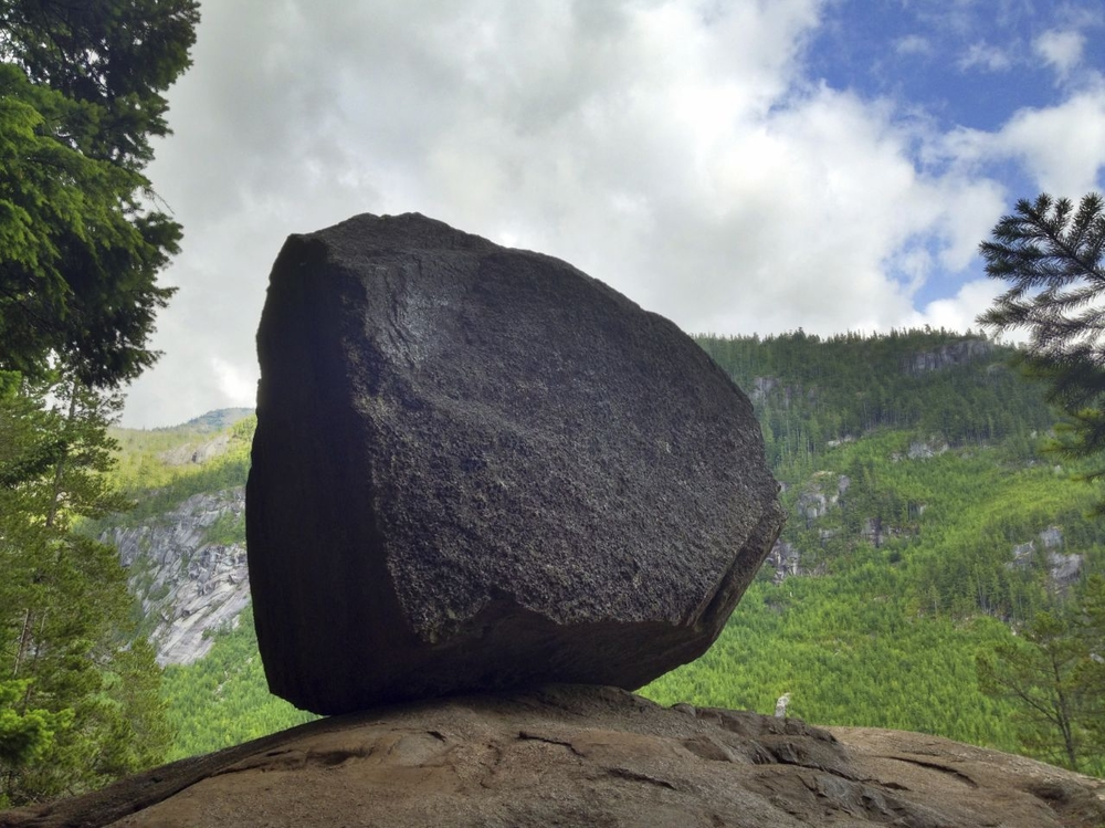 This huge boulder sits off the side of the trail at an overlook about 2/3 the way to the top.