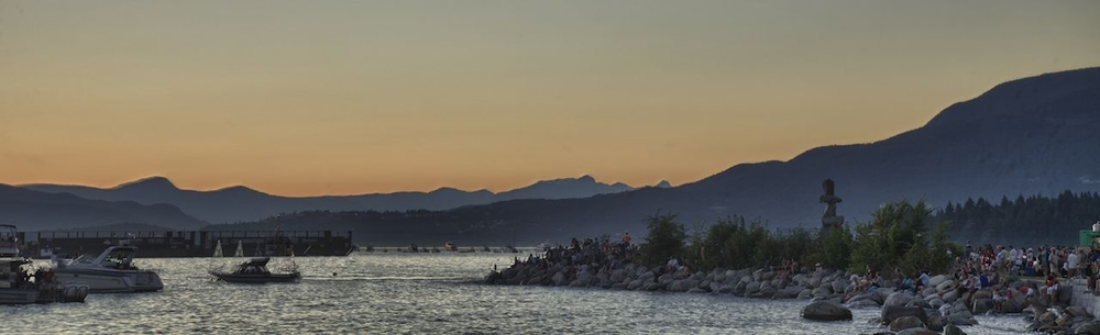 A panoramic view of English Bay as the sun sets.