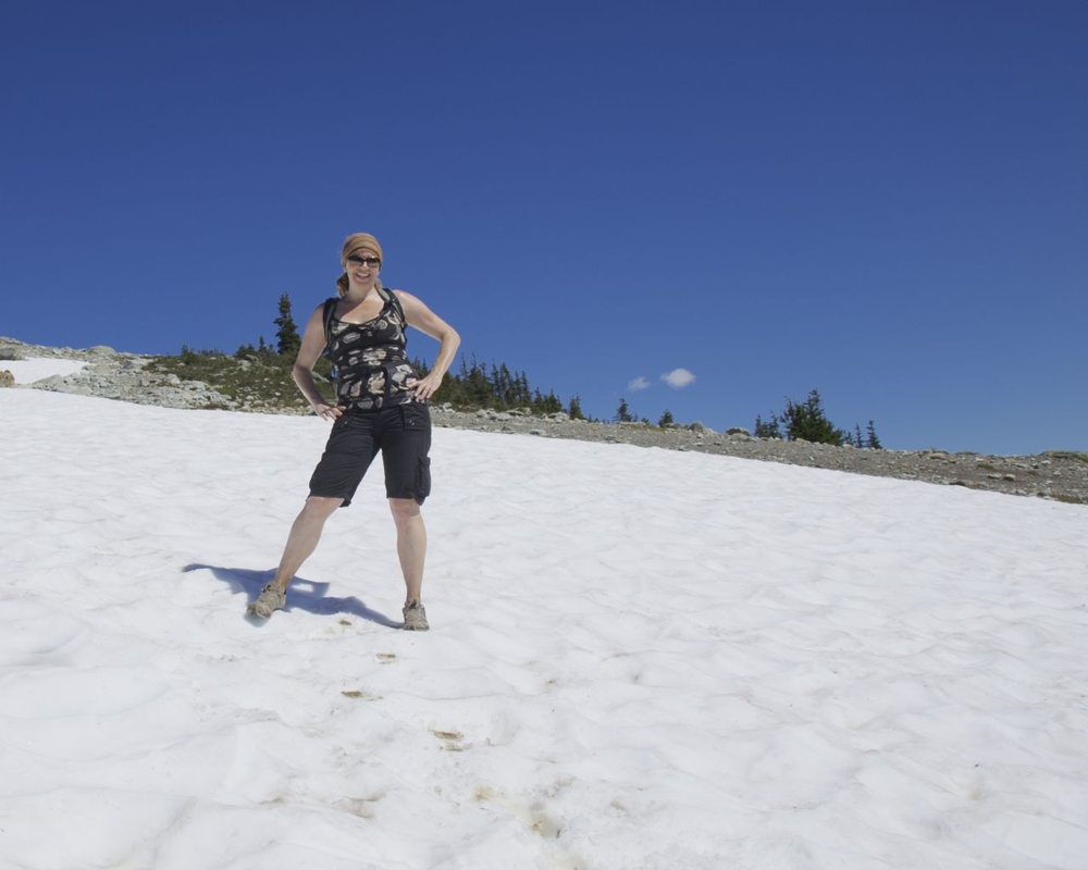 Justine on one of the many snow fields we had to cross over the course of the day. It's fun throwing snowballs in August!