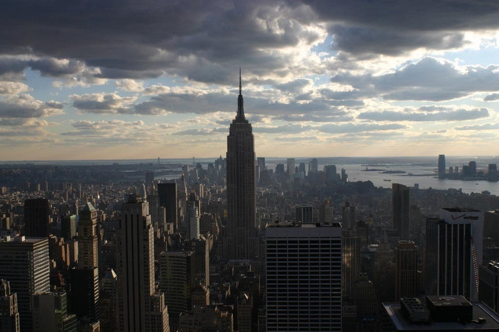 The New York Skyline at sunset. Both pictures taken from the observation deck of the Rockefeller Center.