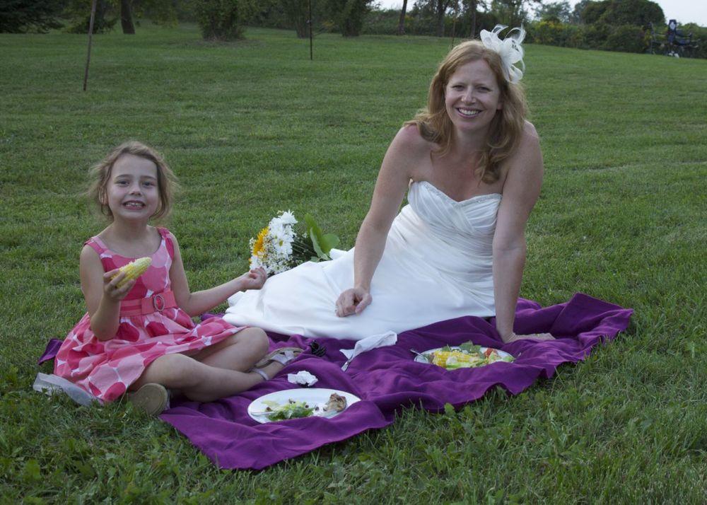 Justine and her flower girl Mackenzie having some dinner on the grass.