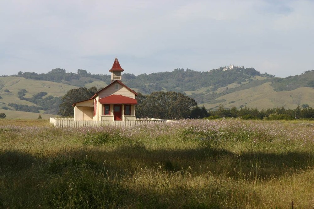 Abandoned church, California. Hearst Castle in the background.  April 2007.