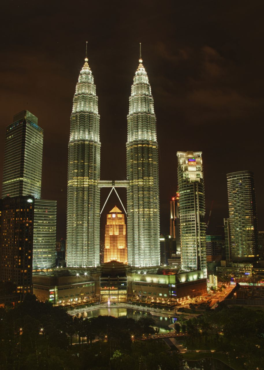 The Petronas Towers, lit up at night.