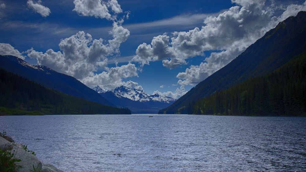 One lone canoe navigates the waters of Duffey Lake.