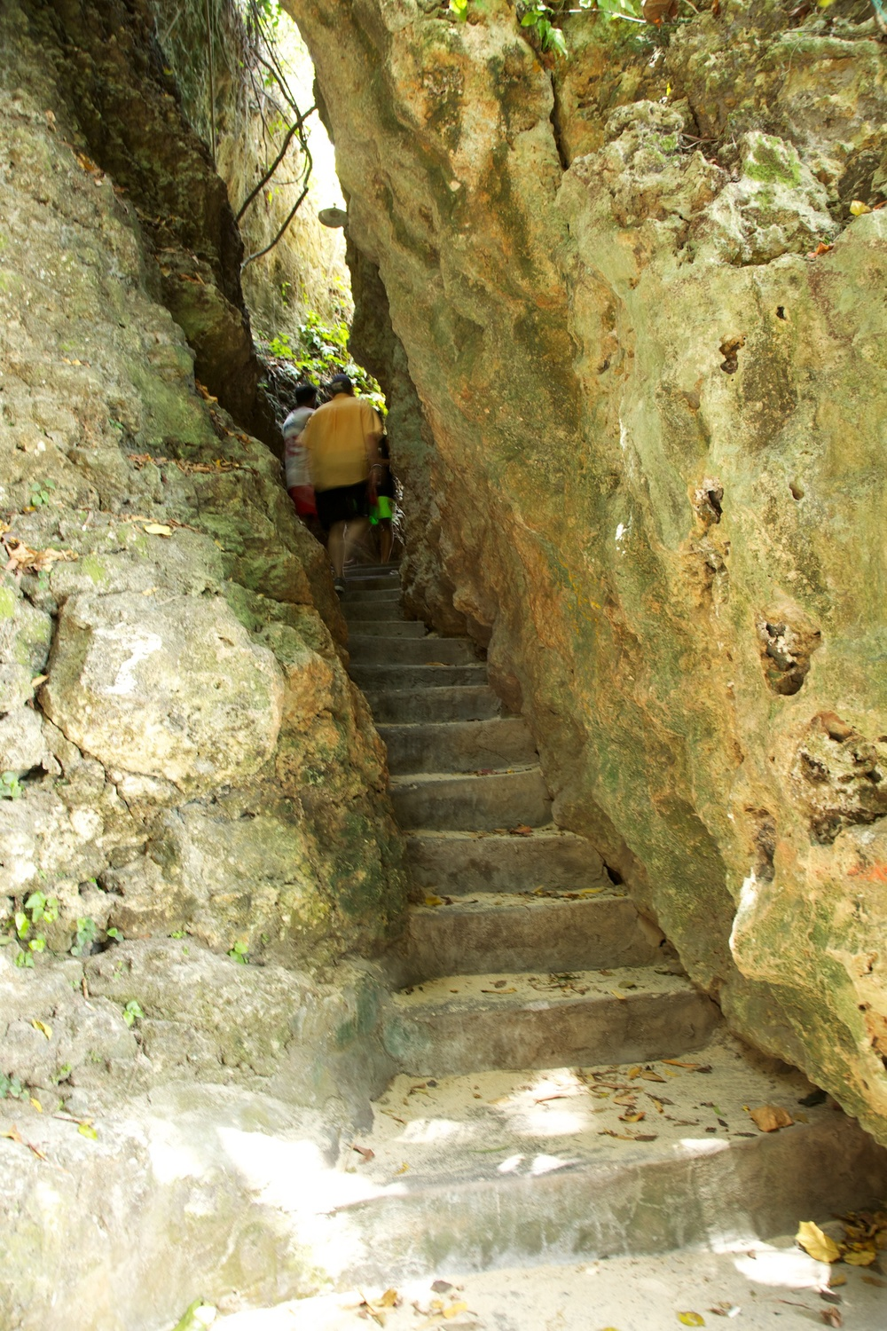 The stairs down to the beach at times were very narrow, and cut right through the rock.