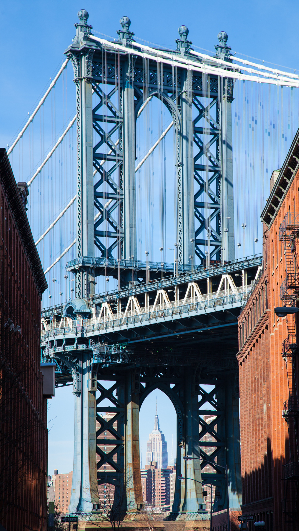 The Manhattan Bridge perfectly frames the Empire State Building back across the river in Manhattan.
