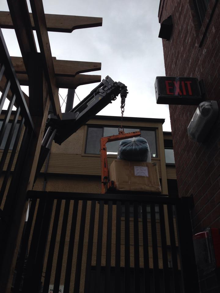 Yep, they used a crane to put the patio furniture on the deck... Photo courtesy Justine Bookbinder.
