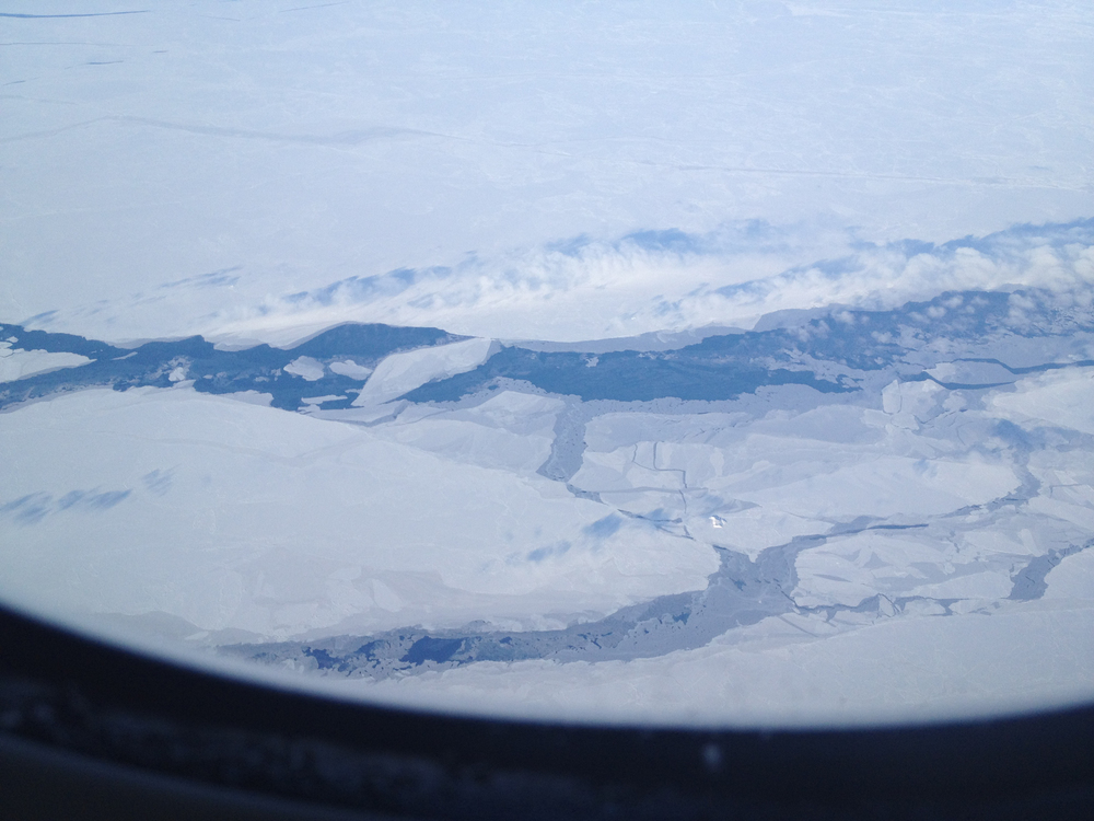 I don't normally have window seats on my flights, so i don't often see what were flying over. In this case, as we were between Greenland and Canada I happened to look out and was amazed by the sea ice. From 37,000', that's a big channel through the ice.