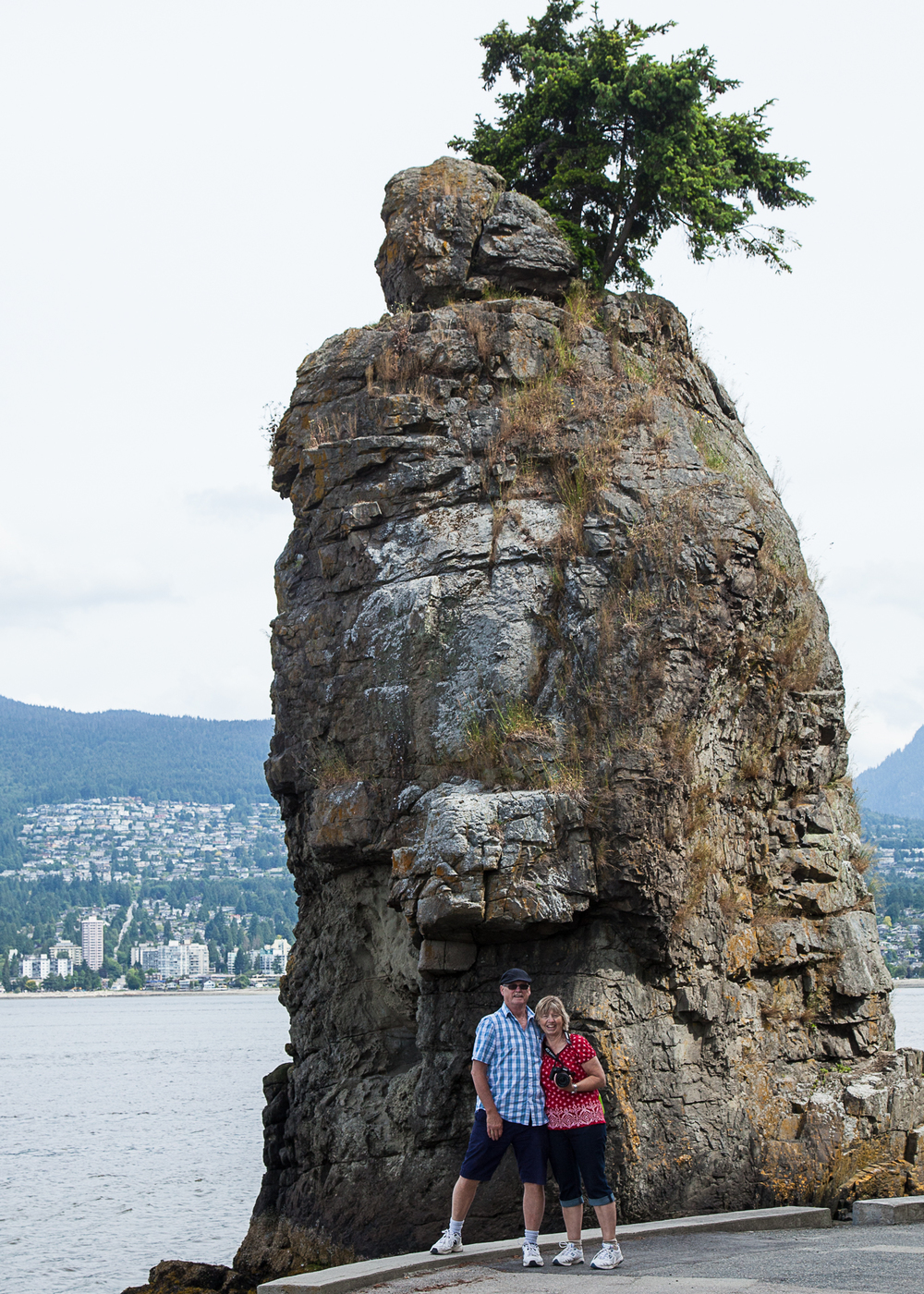 Mom and Dad posing in front of Siwash Rock on the seawall, in Stanley Park.