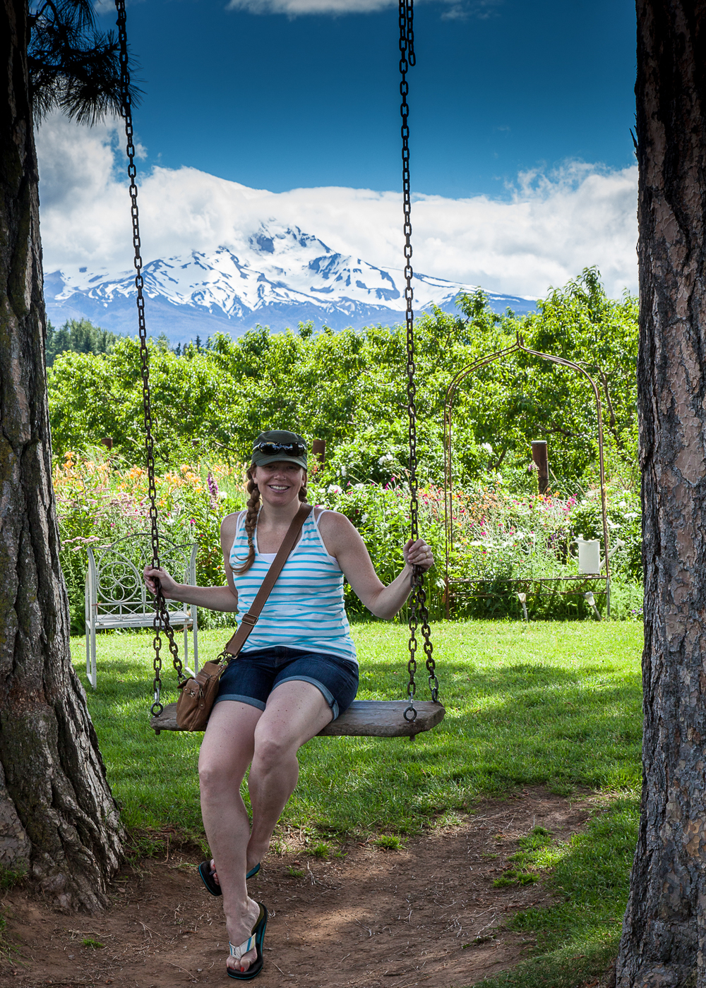 Justine on a swing, with Mount Hood in the background.