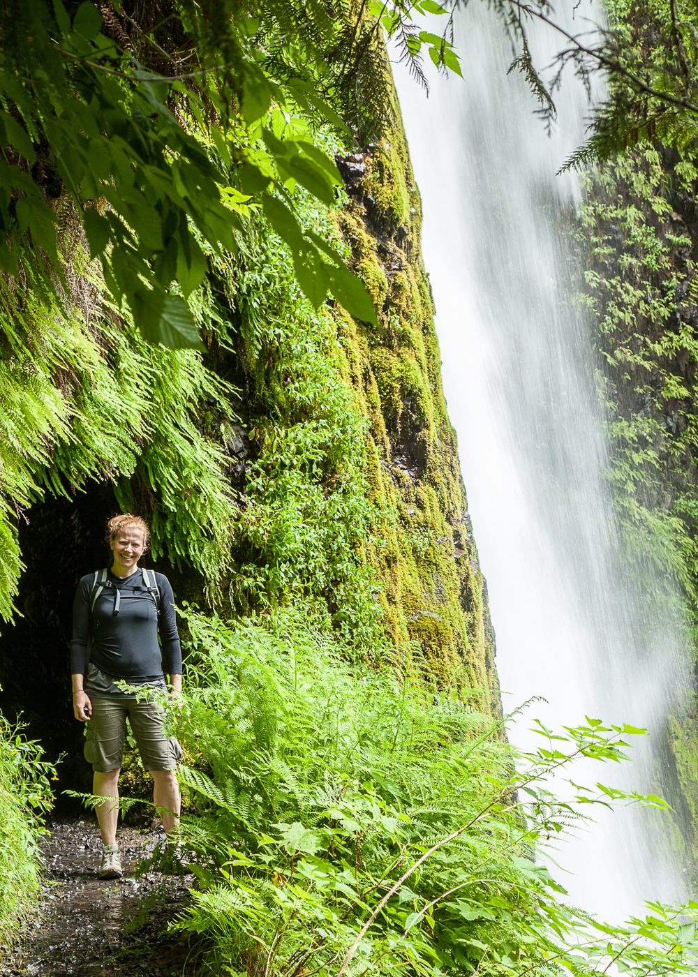 Justine at the entrance to the tunnel behind Tunnel Falls. As you can see, there's a lot of water going over the waterfall.