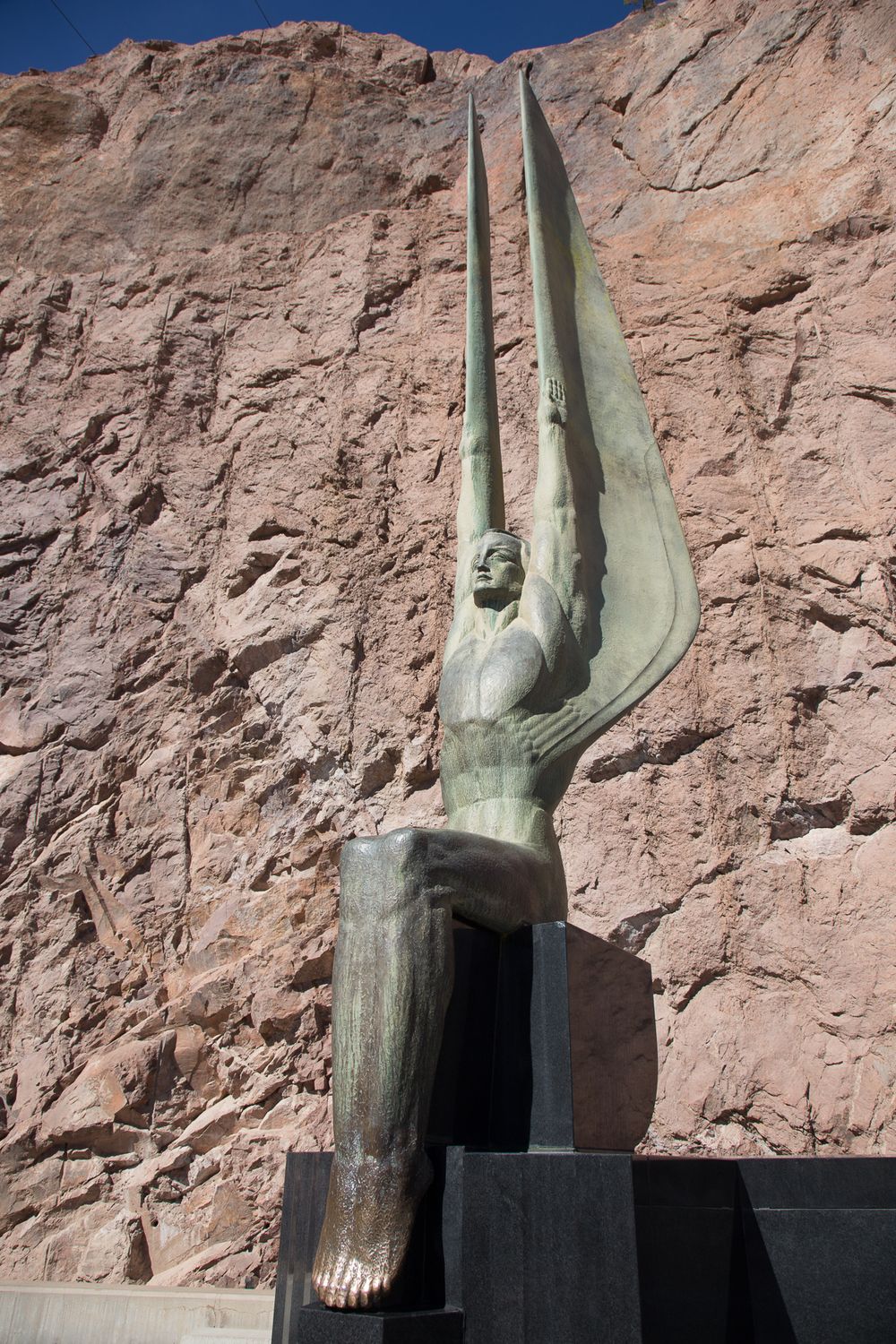 One of the great Art Deco statues outside the Dam. You're supposed to rub the feet for luck.