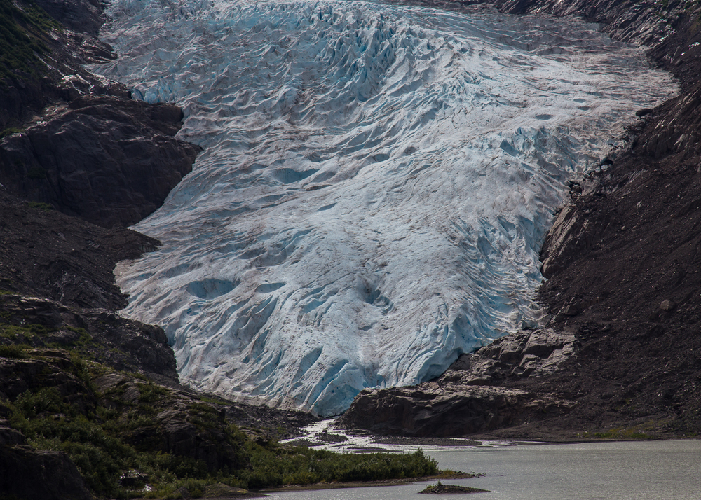 Detail of the Bear Glacier as it reaches down to the small lake at the base of the mountain.