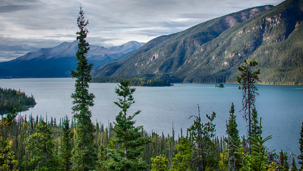 View of the very blue waters of Muncho Lake.