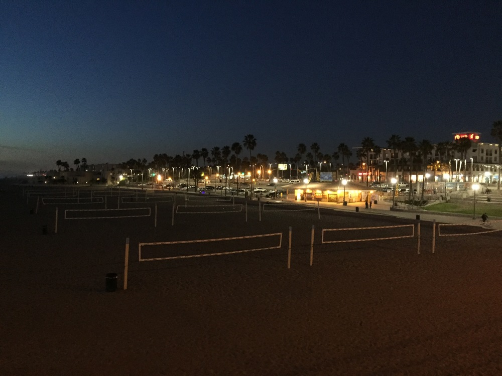 Beach volleyball nets at night