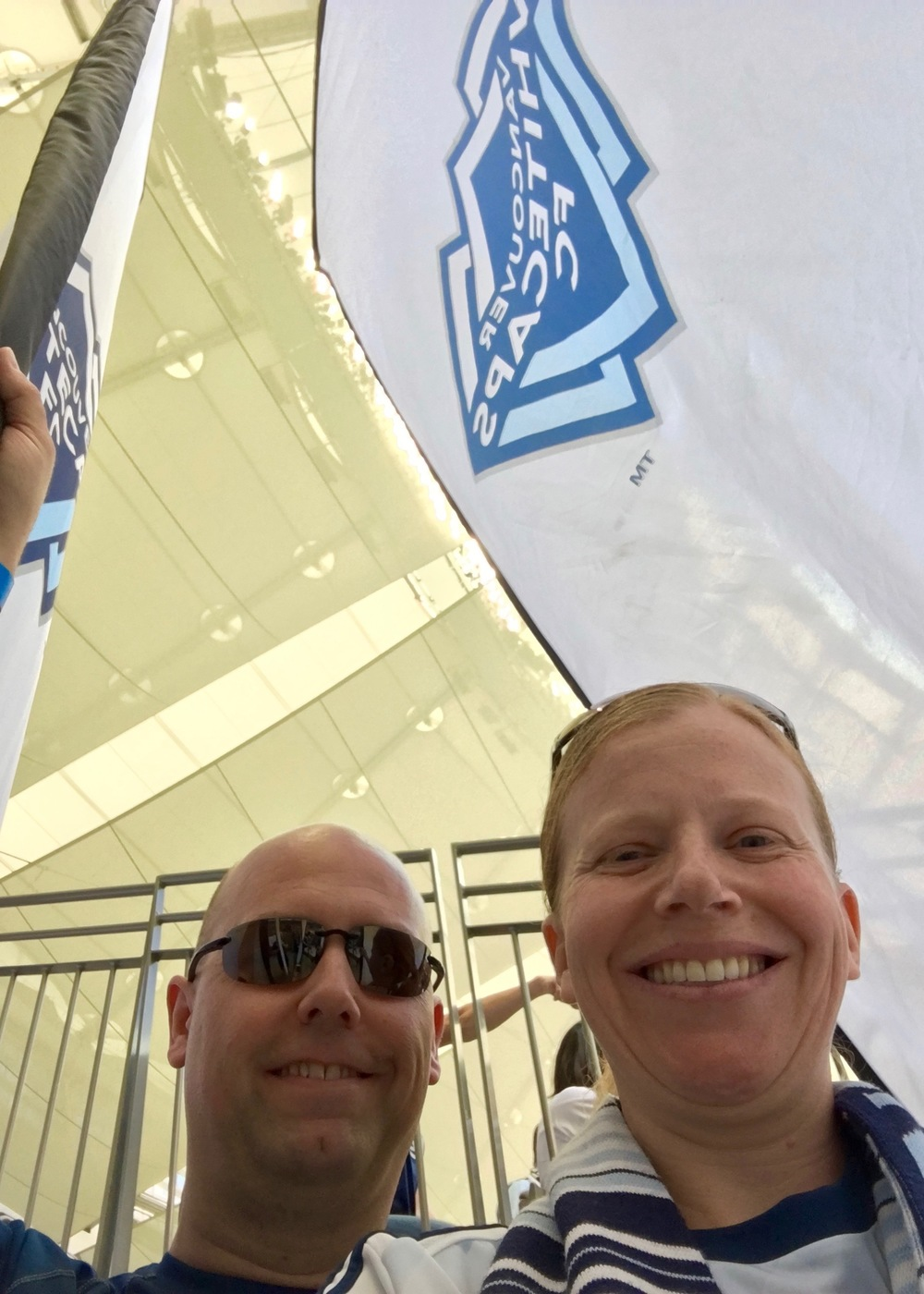 Justine and I with the Whitecaps flags before the game!