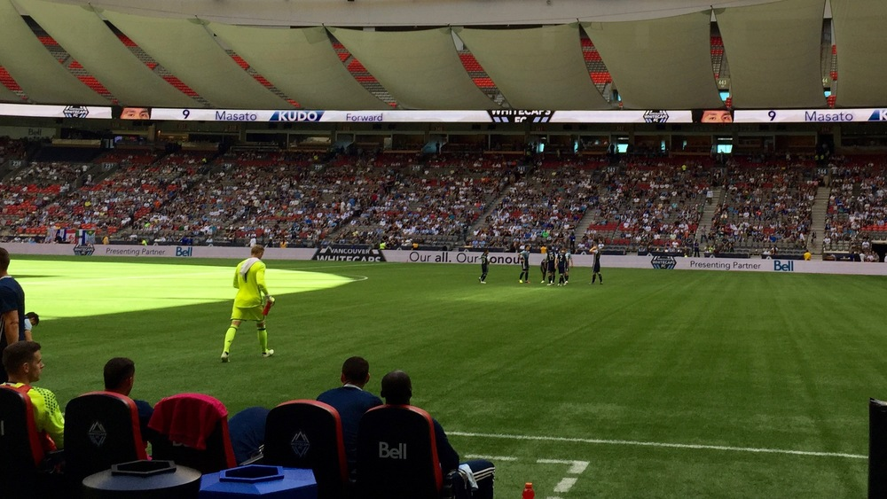 The Whitecaps keeper, David Ousted heading out for the start of the game.