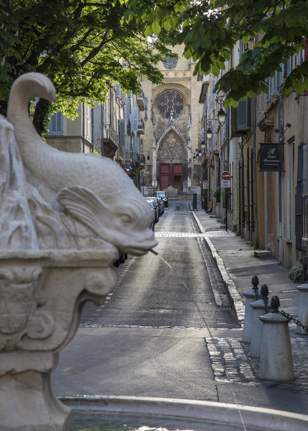 La Place des Quatre Dauphins, and it's fountain, looking up towards l'Eglise du Saint Esprit.