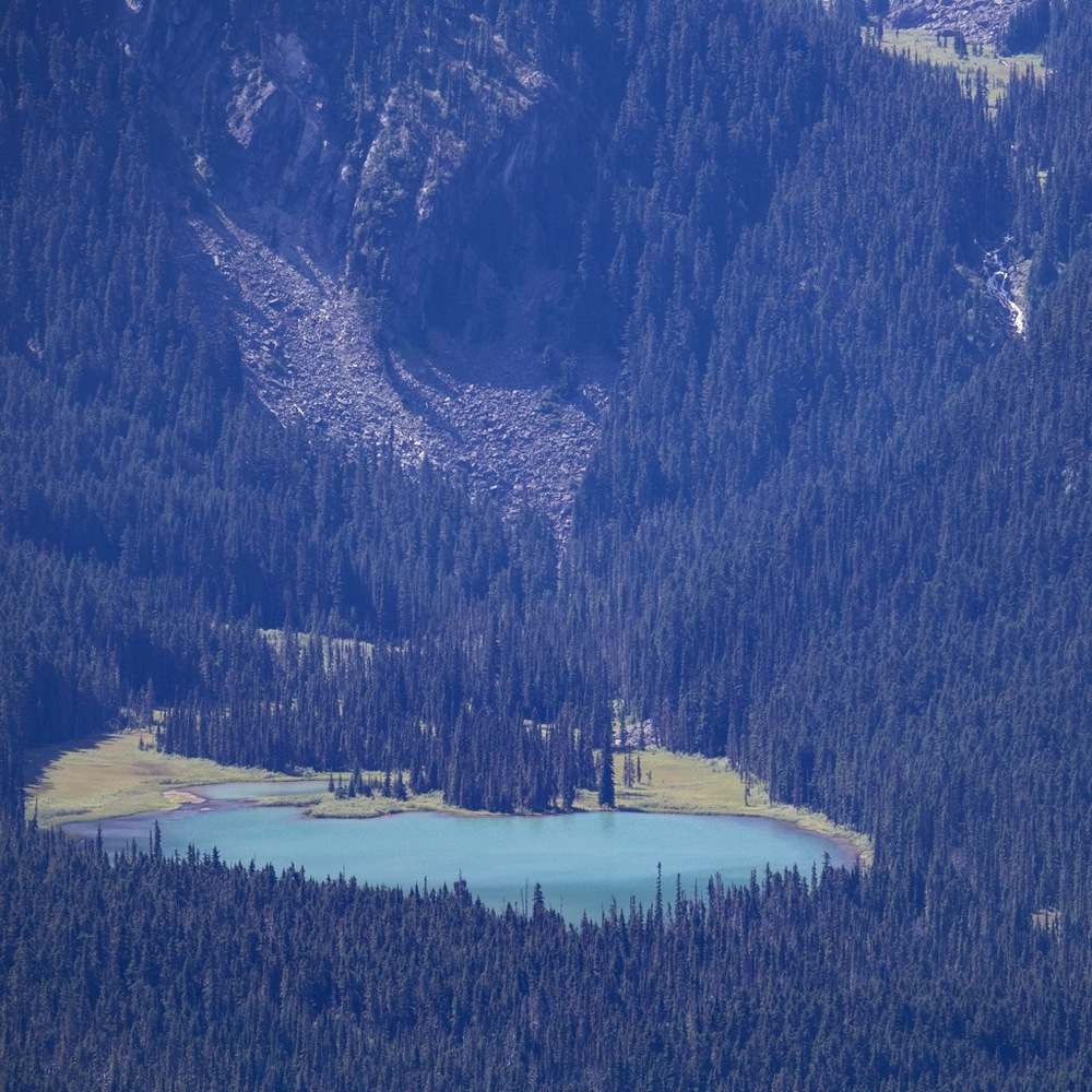 Again, the telephoto lens allows a better view of our favourite little lake, tucked in the mountainside.