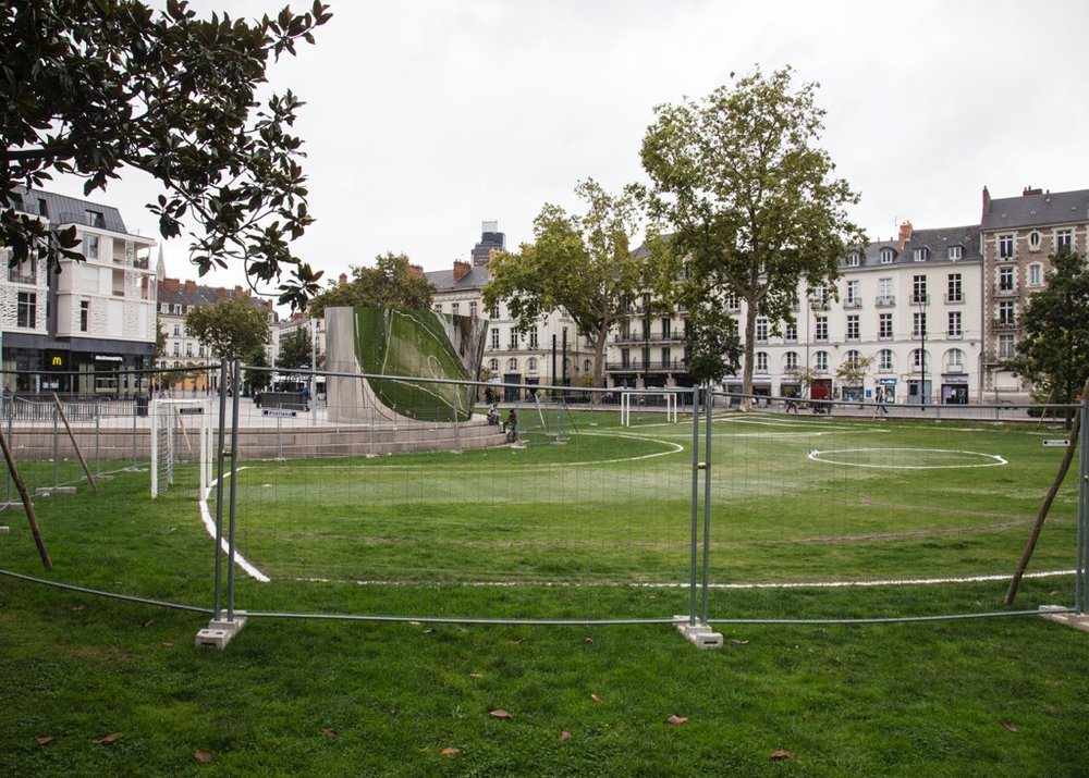 An outdoor art display being put together. Pretty hilarious really - a curved football pitch, but it you watched in the mirror mounted above, the field look normal. Very creative.