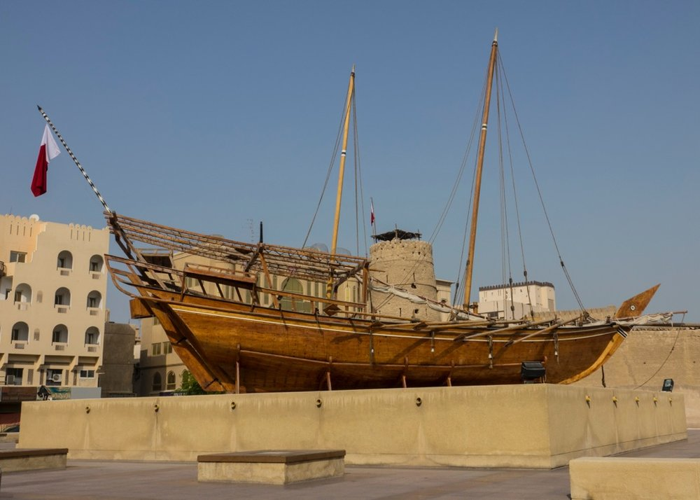 An old sailing ship, on display out front of the Dubai Museum.