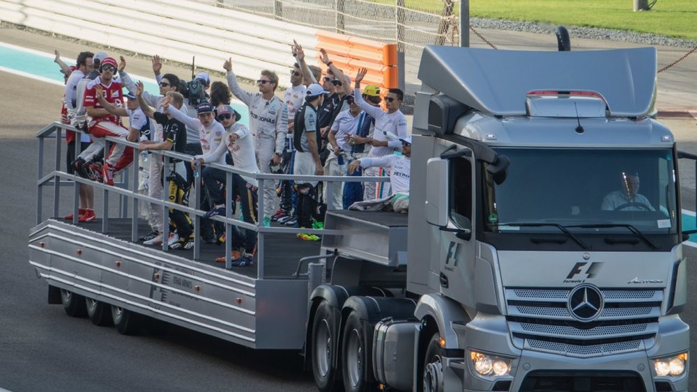 All the drivers on a truck, doing the drivers parade before the race.
