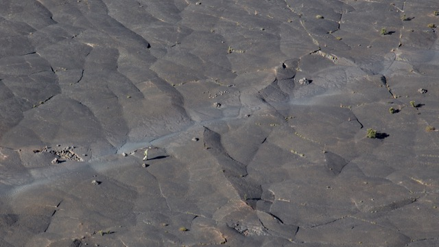 For a sense of perspective, the hiker on the trail across the crater floor