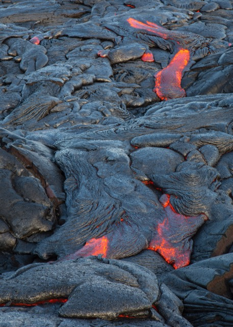 New lava flows, oozing from the earth.