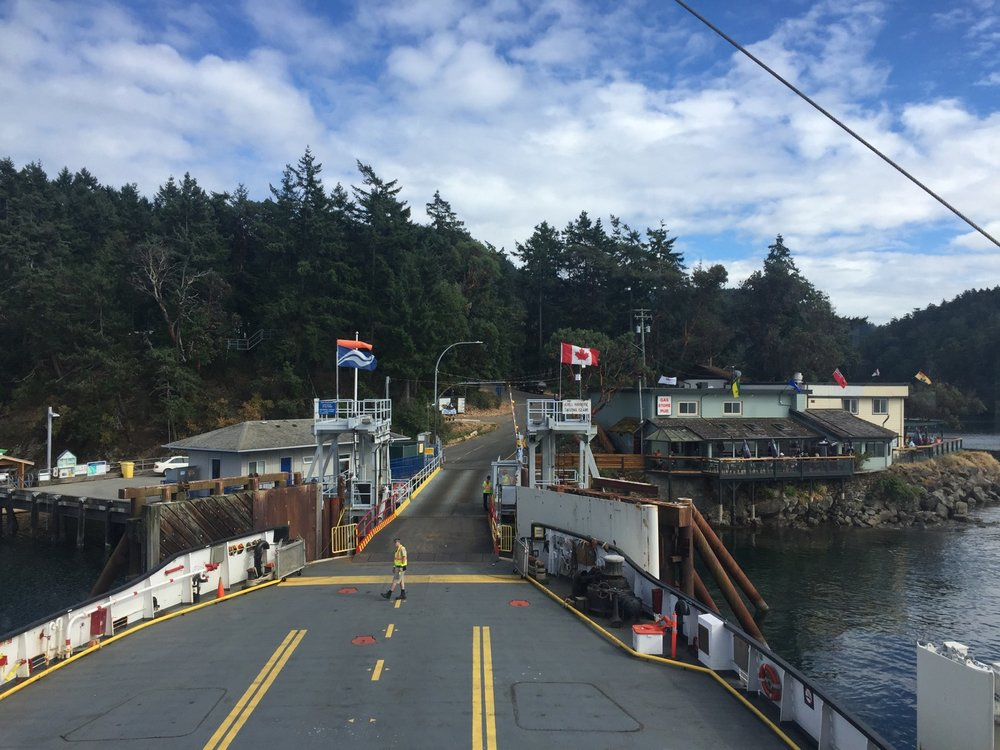 On the smaller ferry heading out from Saturna Island after a fun day. Pub to the right.