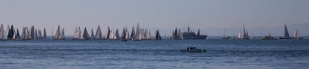 The start of the race, with the warship firing off to get the festivities going.