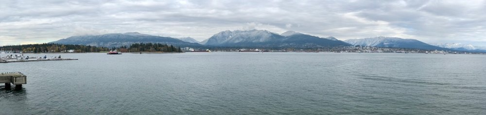A panoramic look across to the first snow of the year on the north shore. Click to see it big...