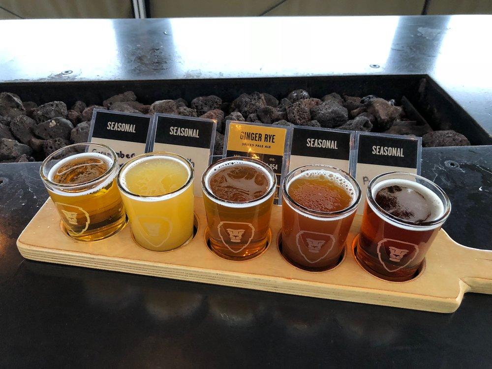 A tasting flight at Aslan Brewing. Good beer, and good food.