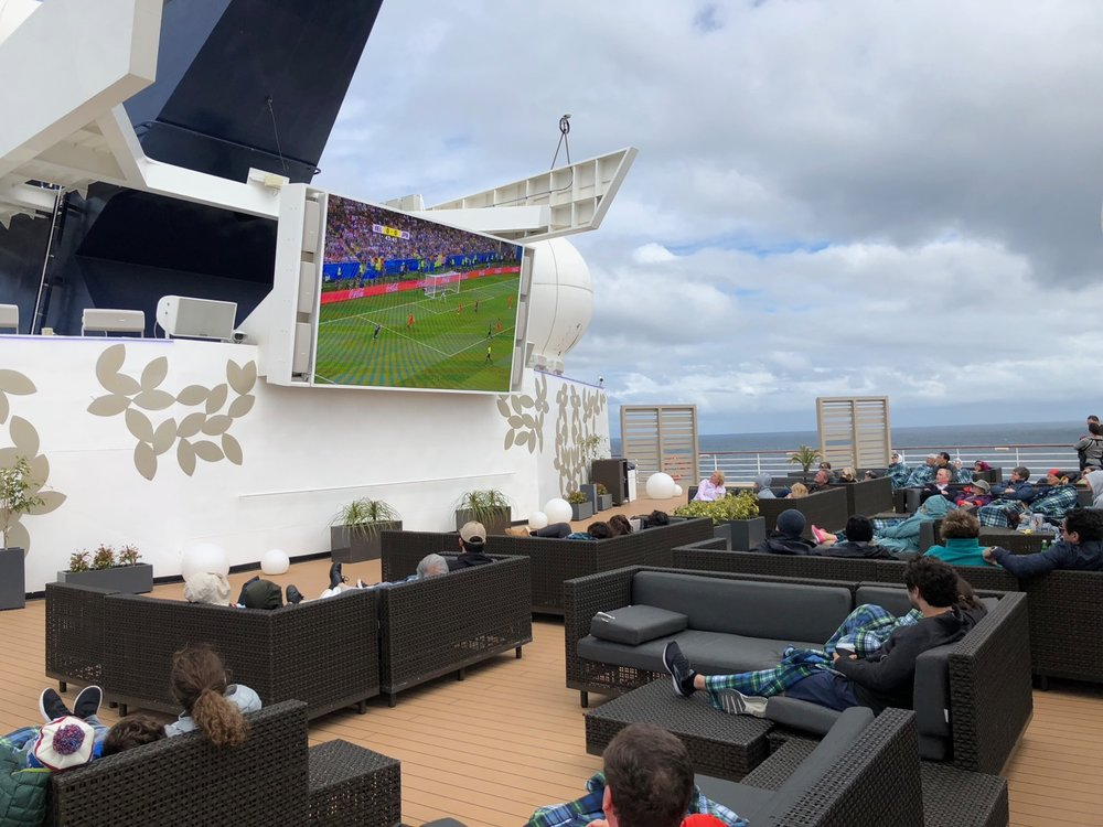 Watching the game on our first full day at sea.