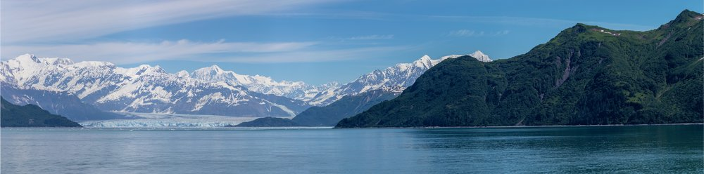 From a few miles out, the Hubbard Glacier at the foot of the mountains.