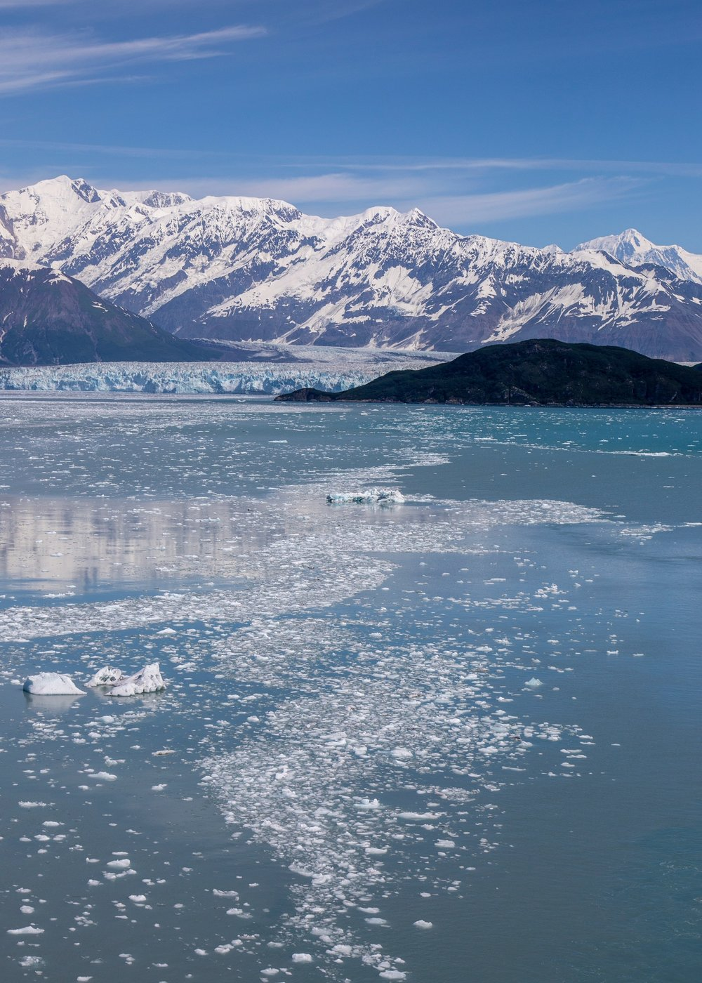 One of my favourite shots - floating ice, the glacier and the mountains that feed it all. Such an amazing view.