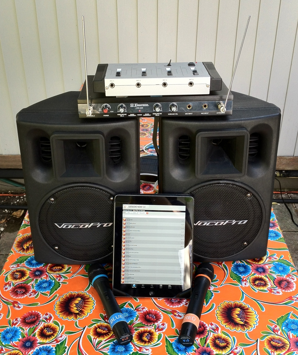 Top to bottom: mixer, wireless microphone receiver, speakers, iPad, and wireless microphones.