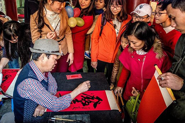 A calligrapher paints inspiring words for revelers during Tet, Vietnam's New Years celebration. 🇻🇳 In the north and Hanoi, Chinese characters are traditionally used in these prints. . . Temple of Literature, Hanoi, Vietnam, 2015 . . #travel #instagood #photography #photooftheday #travelgram #picoftheday #instatravel #travelling #traveling #travelphotography #photographer #wanderlust #igtravel #instapassport #mytravelgram #traveltheworld #traveladdict #explore #adventure #travelstoke #vietnam #southeastasia #hanoi #asia #chinese #temple #vietnamese #calligraphy #amazingasia #tet