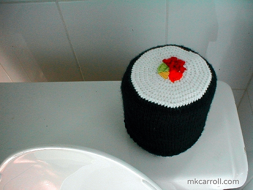 Crochet maki sushi roll that doubles as a cozy for your loo roll