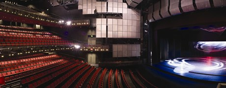 The lovely theater of Sadler's Wells.    This picture is from Sadler's Wells website:     www.http://www.sadlerswells.com/venue-hire/auditorium/
