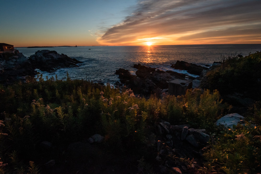 Sunrise off shore by Portland Head Light