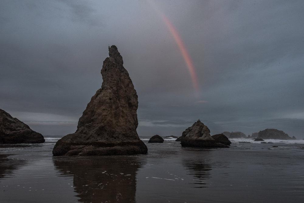 Misty Rainbow over sea stacks