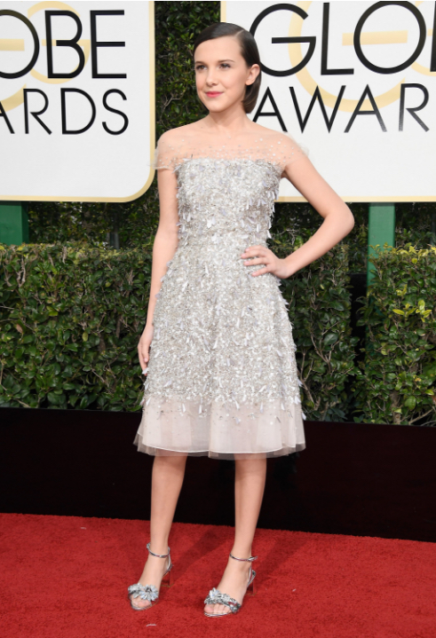 Milly Bobby Brown in Jenny Packham, via  Vogue