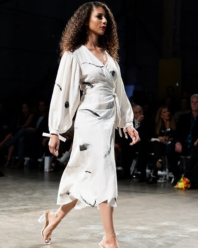 The hand painted wrap dress from @autark_ gracing the runway at Austin Fashion Week.⠀⠀⠀⠀⠀⠀⠀⠀⠀ ⠀⠀⠀⠀⠀⠀⠀⠀⠀ A hero piece of the third Autark collection, this remarkable dress is elegantly undone perfection. Cut from a print hand painted onto the fabric by a local Adelaide artist, every piece cut from this silk-linen fabric is entirely unique.⠀⠀⠀⠀⠀⠀⠀⠀⠀ ⠀⠀⠀⠀⠀⠀⠀⠀⠀ #autark #slowfashion #shoplocal #austinfashionweek #australianbrand #ethicaldesign #thefashionfuturist