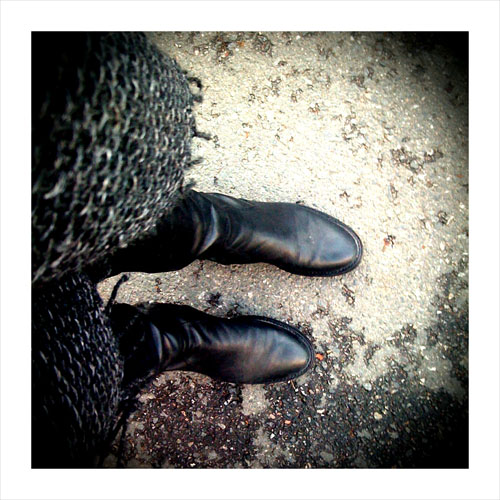 Black boots and Italian basketweave scarf.