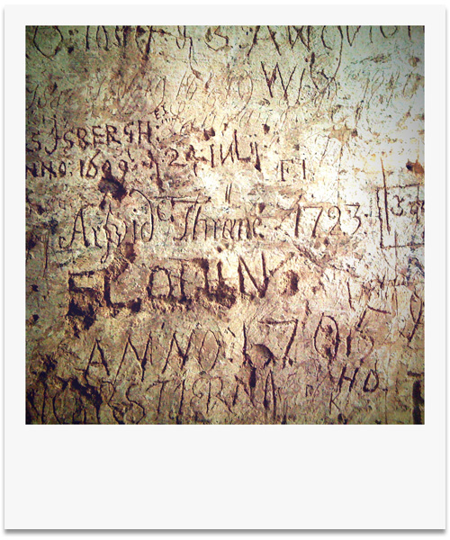 iPhone photography: Centuries of layered graffiti on the wall of a castle ruin.