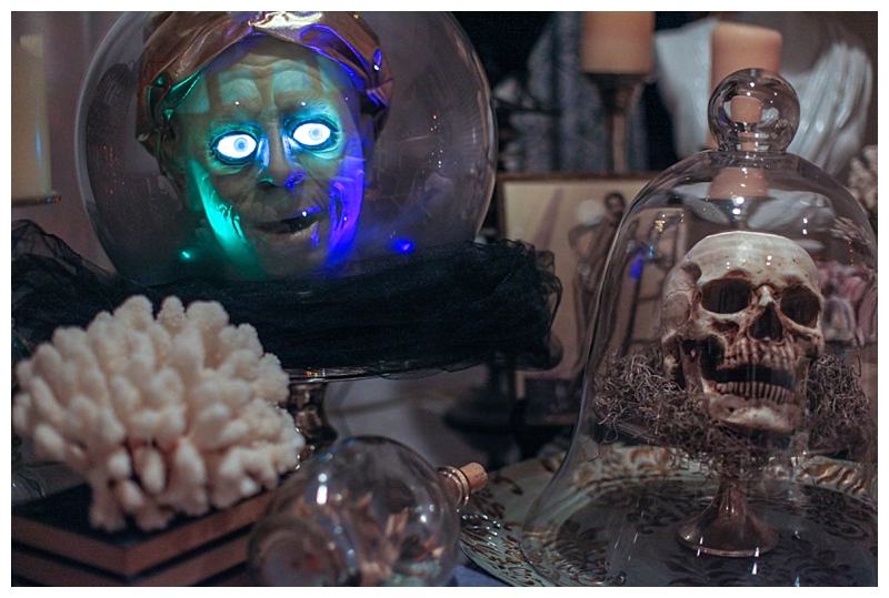One of my favorite Halloween decorations is this Zoltar Spirit Ball. I use it as the centerpiece for my dining table.   I think the plastic legs look a little cheesy so I removed them and instead covered the base in black tulle and placed him on top of a vintage silverplate platter. Much more chic.