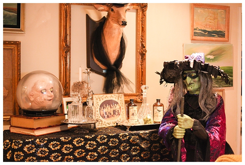 We usually have our animated witch on the porch on Halloween night. Until then we have her mixing up postions and casting spells next to a collection of crystal decanters filled with moss and other spooky items.