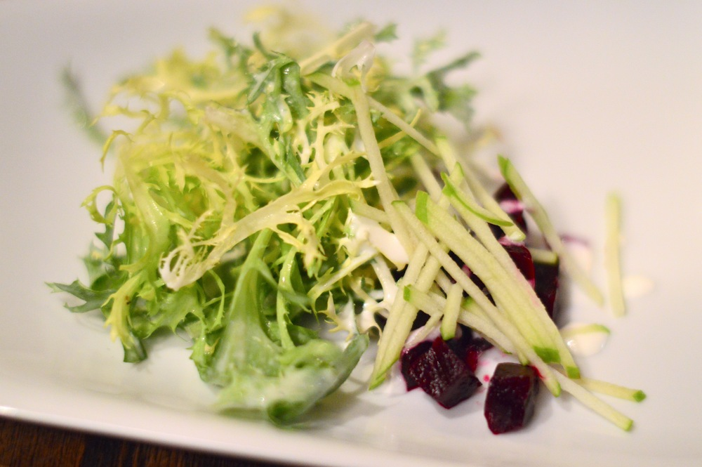 Frisee salad with lemon goat cheese dressing, shredded apple and beet root.