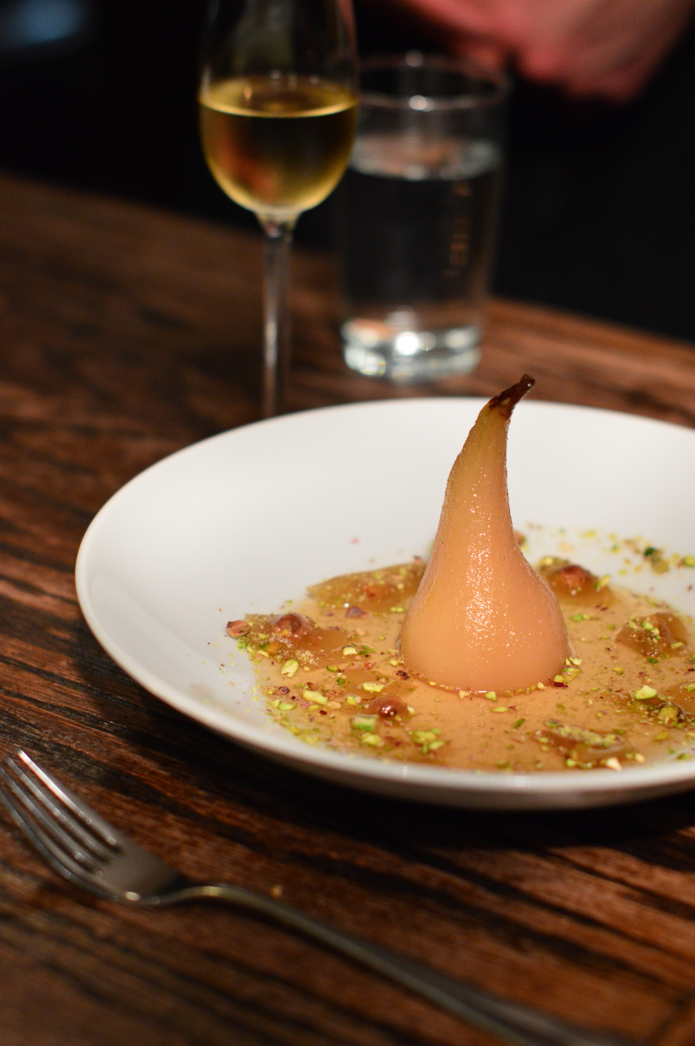 For dessert! Poached pear with muscat syrup and pistachio brittle. Paired with Strewn Select Late Harvest Vidal.