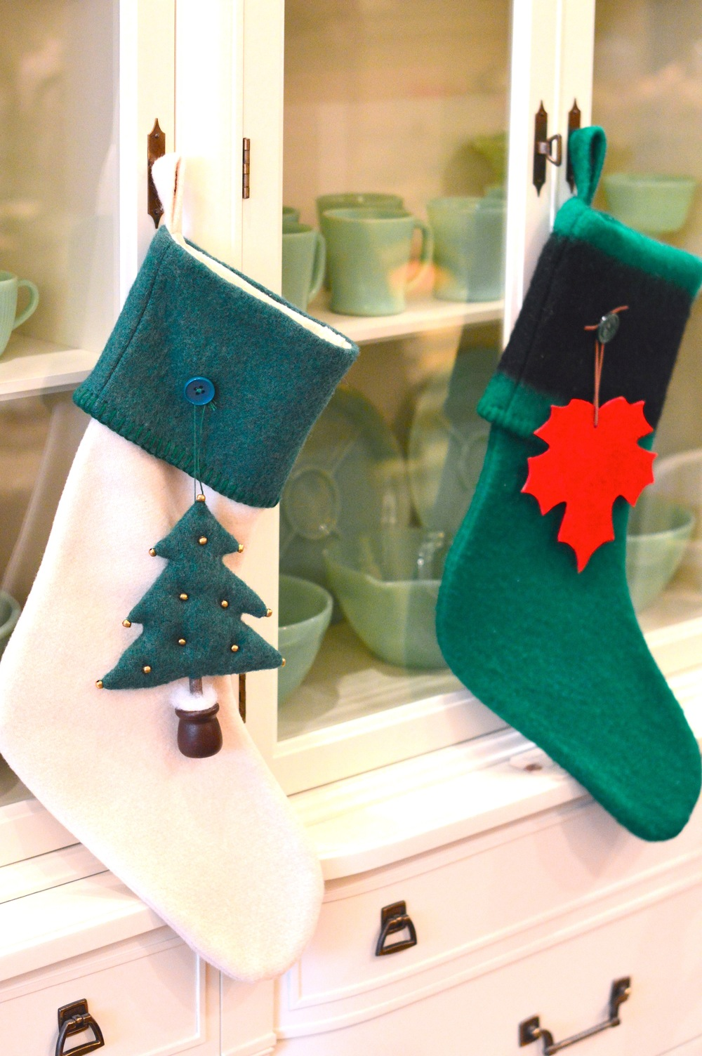 These stockings are handmade by Lynne  Belden out of reclaimed Hudson Bay blankets and each is adorned with an ornament like wooden skis, snowmen and maple leafs.